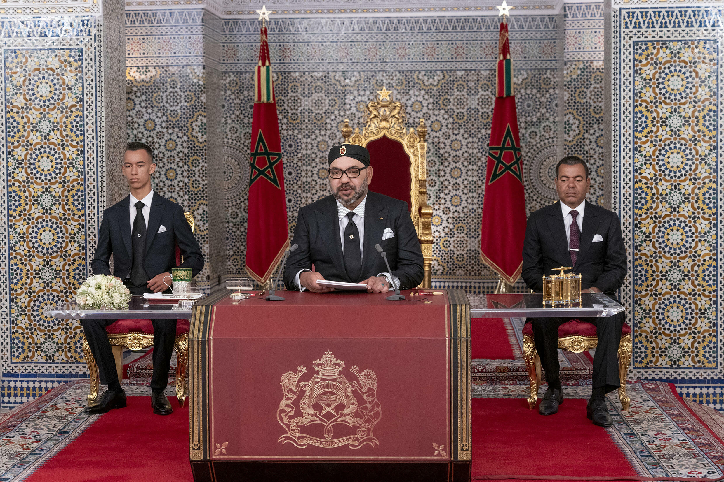 Despite the changing of the guard, policy changes are unlikely as major decisions in Morocco still come from King Mohammed VI (C)