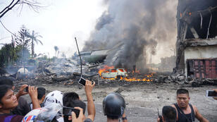 An Indonesian military transport plane crashed in Medan on June 30 shortly after taking off and exploded in a ball of flames in a residential area.