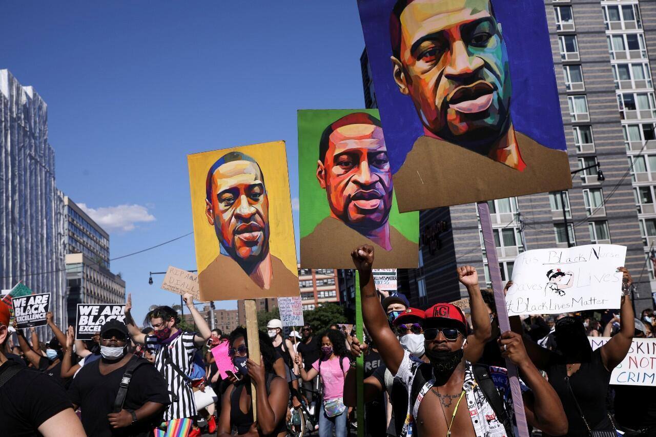 Archive-Protesters hold up posters depicting George Floyd in New York, USA.  June 13, 2020.