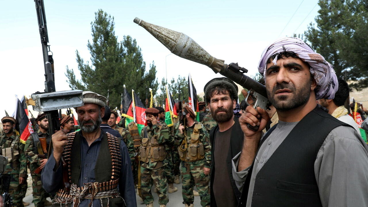 Armed men at a gathering to announce their support for Afghan security forces and the anti-Taliban fight on the outskirts of Kabul, Afghanistan, June 23, 2021.