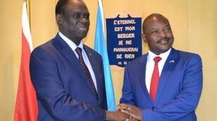 UN envoy for Burundi Michel Kafando (left) shakes hands with President Pierre Nkurunziza during a visit in 2017