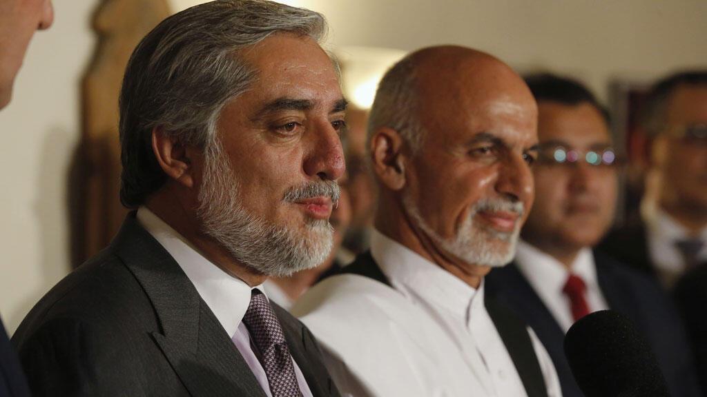 Afghan presidential election challenger Abdullah Abdullah (foreground) and incumbent President Ashraf Ghani.