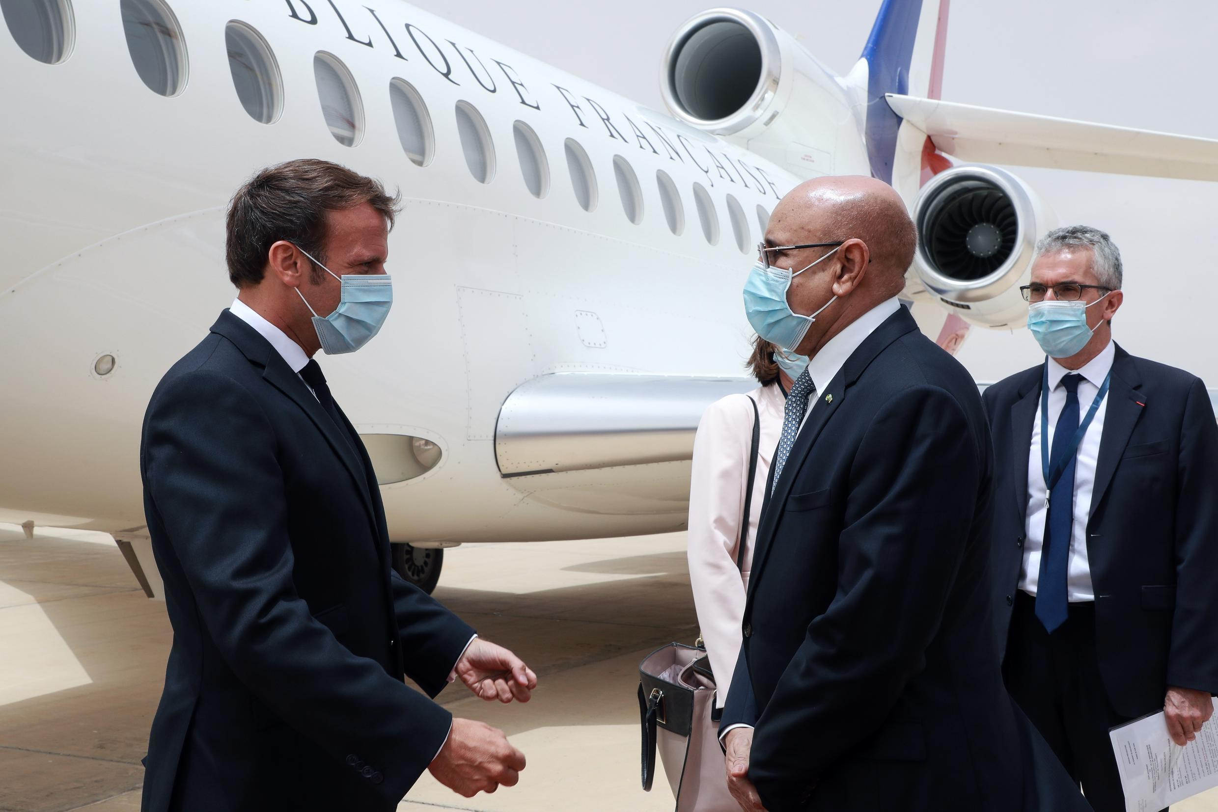 French President Emmanuel Macron is greeted by his Mauritanian counterpart Mohamed Ould Ghazouani at Nouakchott on June 30, 2020.