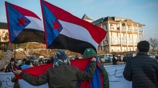 Protesters holding South Yemen flags demand independence for the region during a protest outside the venue of UN peace talks at Rimbo in Sweden