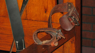 Fanny Carrier, AFP | The leather arm straps of a decommissioned electric chair pictured at the Texas Prison Museum in Huntsville, Texas.