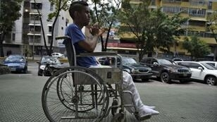 A patient leaves after receiving treatment for kidney failure at a state-run clinic in Caracas, on March 10, 2019