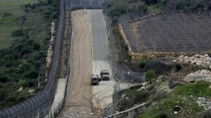 The fence separating the Israeli-annexed Golan Heights from Syria is patrolled by Israeli military vehicles