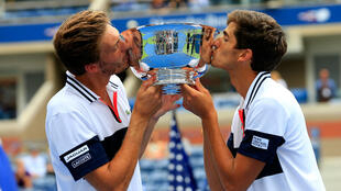 Pierre-Hugues Herbert (L) and Nicolas Mahut (R) of France celebrate their win in the Men's Doubles Final match at the 2015 U.S. Open on September 12, 2015 in New York City.