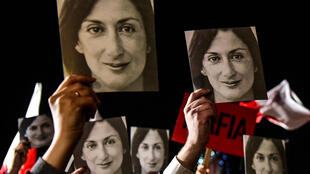 "File photo taken on November 29, 2019 of protesters with placards reading ""Mafia Government"" and photos of killed journalist Daphne Caruana Galizia in Valletta, Malta."
