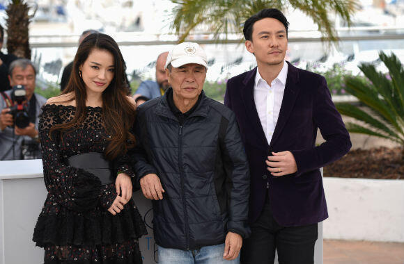 "From left to right: Shu Qi, Hou Hsiao-Hsien and Chang Chen attend Thursday's photocall for ""The Assassin""."