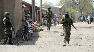 Soldiers patrol the streets in the remote northeast town of Baga, Nigeria, on April 30, 2013