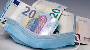 A protective face mask filled with banknotes in Paris, on July 21, 2020.