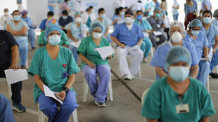 Peruvian health care workers queue to receive the first dose of the Covid-19 vaccine against COVID-19 in Lima