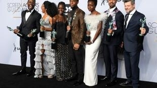 """The global film market grew by nine percent, driven by hits such as """"Black Panther,"""" whose cast is pictured here"""