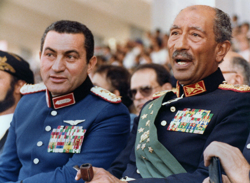 Hosni Moubarak, then vice president of Egypt, with then President Anwar Sadat, a few minutes before the attack that killed Sadat on October 6 1981.