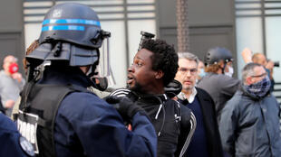 A protester is detained in Lille, France, on  June 4, 2020, during a demonstration in memory of Adama Traore, a black Frenchman who died in a 2016 police operation.