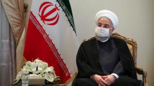صورة وزعتها الرئاسة الايرانية للرئيس حسن روحاني اثناء استقباله وزير الخارجية السويسري في طهران في 7 ايلول/سبتمبر 2020.