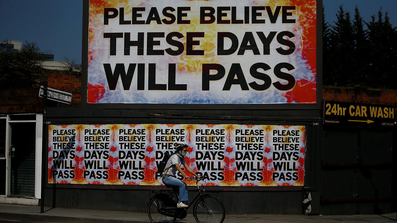 A person cycles past a billboard with a message in Shoreditch as the spread of the coronavirus disease (COVID-19) continues, London, Britain, April 11, 2020.