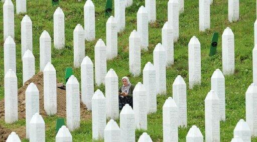 A Bosnian Muslim woman, survivor of the Srebrenica 1995 massacre, at a memorial cemetery in the village of Potocarion in July 2014.