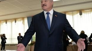 Belarus' President Alexander Lukashenko at a polling station in Minsk on October 11, 2015.