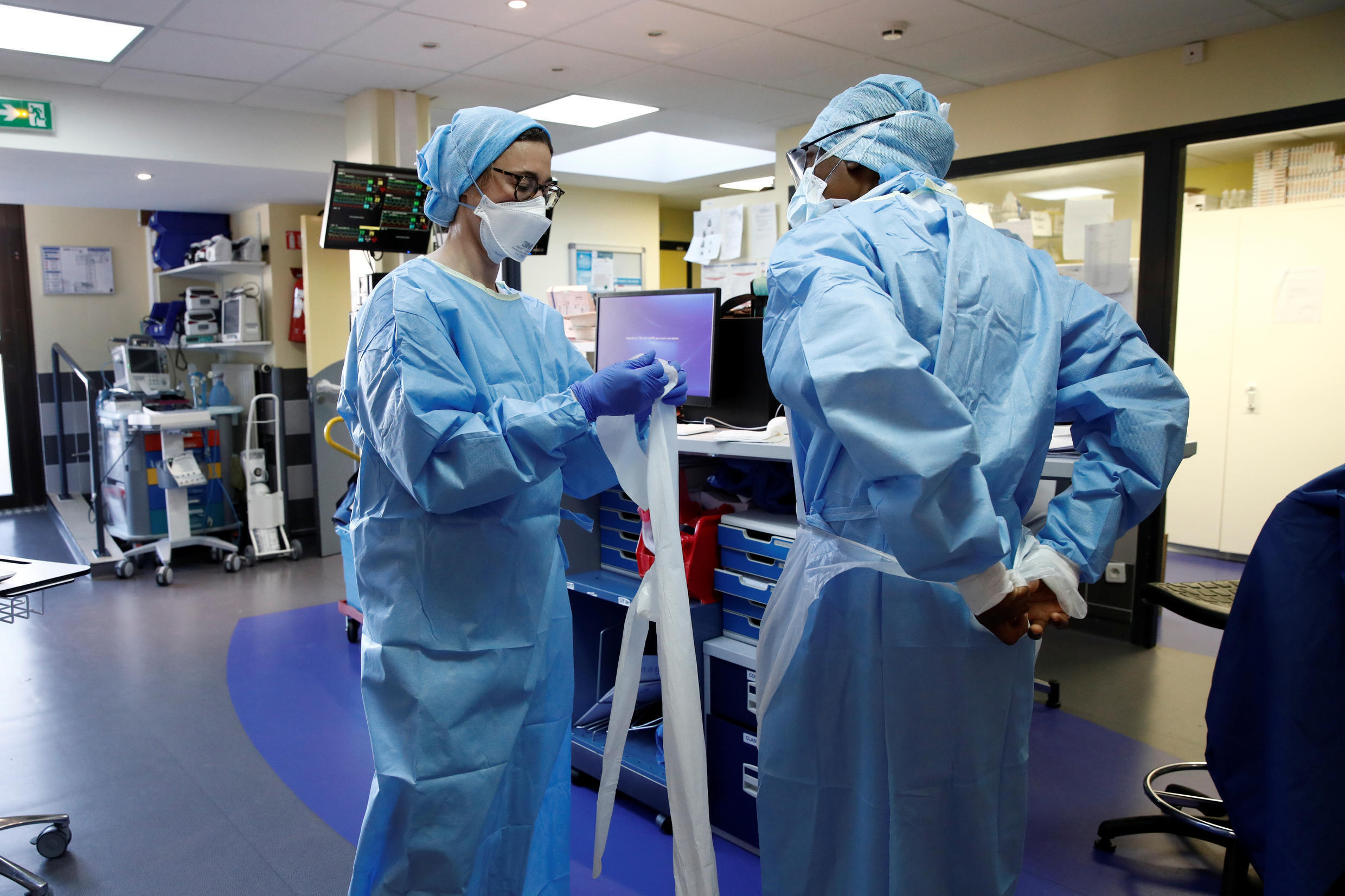 Medical staff, wearing protective suits and face masks, work in an intensive care unit for coronavirus disease (Covid-19) patients at the Franco-Britannique hospital in Levallois-Perret near Paris as the spread of the coronavirus disease continues in France, on April 15, 2020.