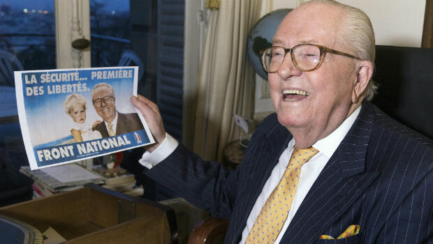 Joel Saget, AFP | Jean-Marie Le Pen holds a campaign poster in which he poses with his granddaughter Marion Marechal-Le Pen, now a French Member of Parliament for the Front National, in Saint-Cloud, west of Paris, on January 27, 2016.