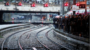 Commuters on a Gare Saint-Lazare train station platform as a strike continues against French pension reform plans, in Paris on December 9, 2019.