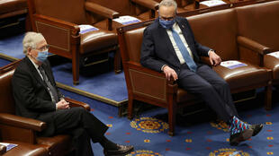 FILE PHOTO: Senate Majority Leader Mitch McConnell (L) and Senate Democratic Leader Chuck Schumer are seen during a joint session of Congress after they reconvened to certify the Electoral College votes of the 2020 presidential election in the House chamber in Washington, U.S. January 6, 2021.