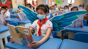 Students are wearing wings to maintain social distancing in Taiyuan in China's northern Shanxi province