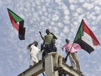 Khartoum crowds celebrate Sudan's transition to civilian rule