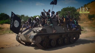 A screengrab taken on November 9, 2014 from a video released by the Nigeria's Boko Haram shows the extremist group's fighters parading on a tank in an unidentified town.