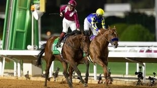 Handout picture of the winner of the Saudi Cup, Mishriff ridden by David Egan, edging out Charlatan in the last moments of the race -- the world's richest