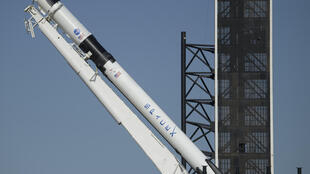 SpaceX's Falcon 9 rocket is raised into a vertical position on the launch pad ahead of the crewed mission to the International Space Station