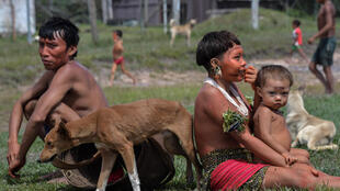 Indigenous Yanomami ethnic group members, seen waiting for COVID-19 tests at the 4th Special Frontier Platoon in Alto Alegre, Roraima state, Brazil, worry that going into cities for medical treatment will mean cutting them off from their culture