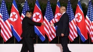 لقاء الرئيس الأمريكي دونالد ترامب والزعيم الكوري الشمالي كيم جونغ أون 12 يونيو/حزيران 2018