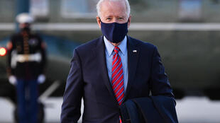 US President Joe Biden (pictured February 5, 2021) is seeking to show his empathy -- and to mark a break from his predecessor Donald Trump, who was accused of not caring about the fate of millions of Americans hit by the health and economic crises