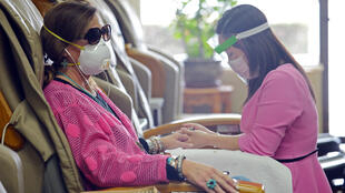 Jeannie Dent gets a manicure from Sally Le at Nail Turbo, during the phased reopening of businesses and restaurants from coronavirus disease (COVID-19) restrictions in the state, in Roswell, Georgia, U.S., April 24, 2020.
