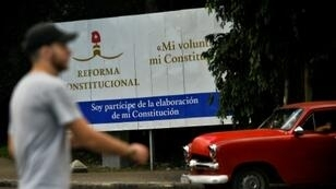 A poster highlights Cuba's Constitutional reform on a street in Havana