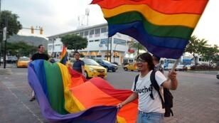 People in Guayaquil celebrate after Ecuador's Constitutional Court approves same sex marriage