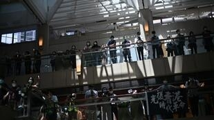 Pro-democracy supporters gather at a shopping mall during a lunchtime rally in Hong Kong on April 29