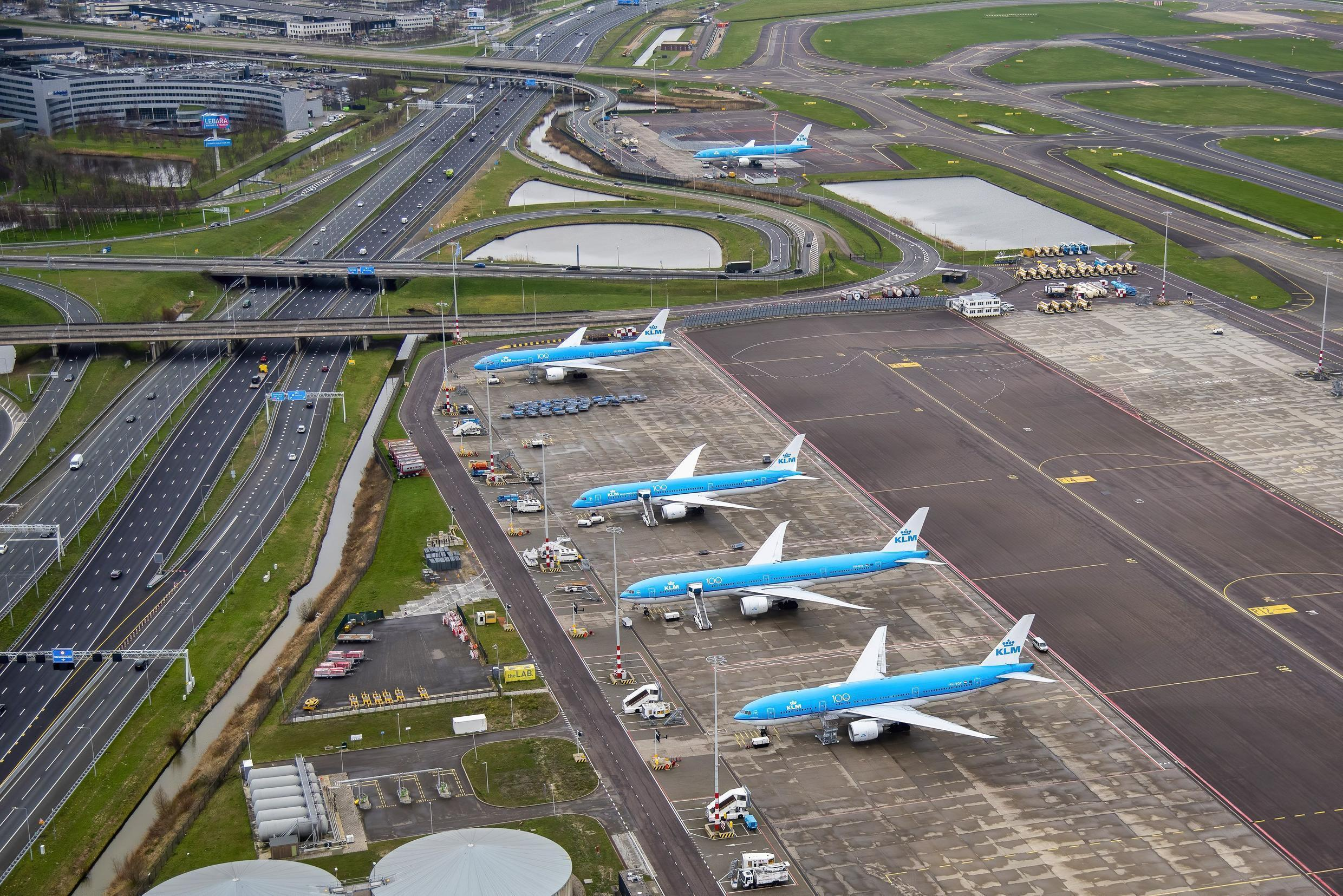 Dutch airline KLM planes parked on the tarmac of the Schiphol Airport, Amsterdam, on March 19, 2020 as several airlines cancel their flights related to the COVID-19 outbreak hitting Europe. Air France-KLM is slashing 90 percent of its flights.