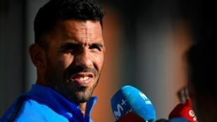 Boca Juniors star Carlos Tevez talks to media at the Spanish Football Federation (RFEF) headquarters in Madrid, ahead of Sunday's Libertadores Cup final against Buenos Aires rivals River Plate.