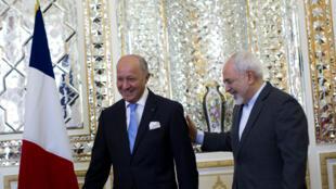 Laurent Fabius et son homologue iranien Mohammad Javad Zarif, à Téhéran, le 29 juillet 2015.