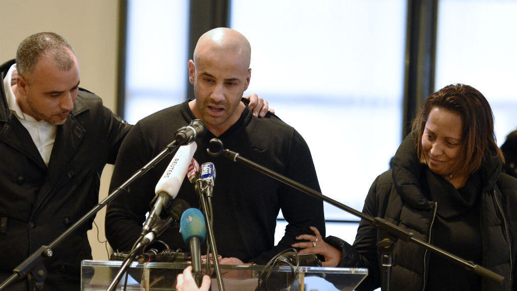 Malek Merabet (C), the brother of slain policeman Ahmed Merabet talks during a press conference in Livry-Gargan, northern Paris suburb, on January 10, 2015 with Ahmed's brother-in-law Lotfi Mabrouk (L), and Ahmed's partner Morgane.