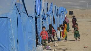 Des enfants de la province de Kunduz dans un camp de réfugiés de la banlieue de Kaboul, en octobre2016.
