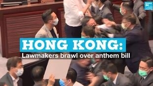 Lawmakers fight inside the Hong Kong legislature on Monday, May 18, 2020.