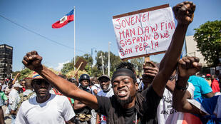 Demonstrators march in Port-au-Prince on February 14, 2021, to protest against the government of President Jovenel Moise