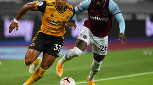 Adama Traore (L) playing for Wolves against West Ham last weekend in the English Premier League.