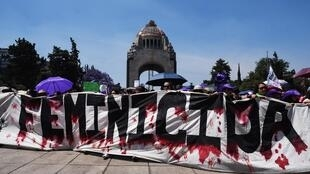 Women demanding an end to femicide protest in Mexico on International Women's Day