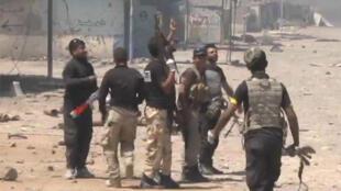 La police fédérale et des milices locales ont pénétré dans Baïji, jusqu'alors contrôlée par l'organisation de l'État islamique.